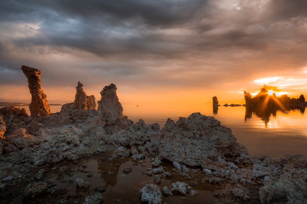 rock formations near calm body of water