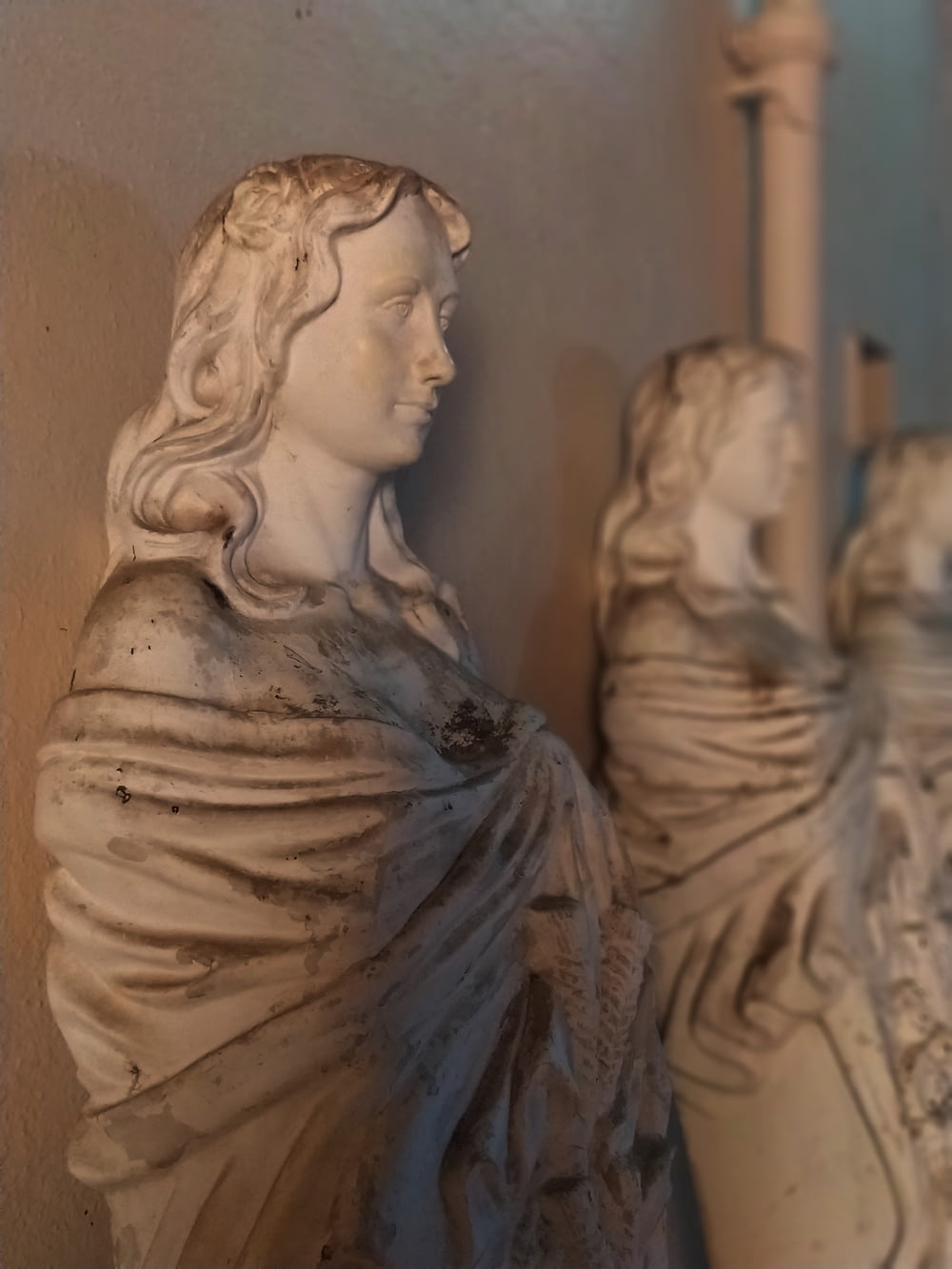 selective focus photography of woman statue