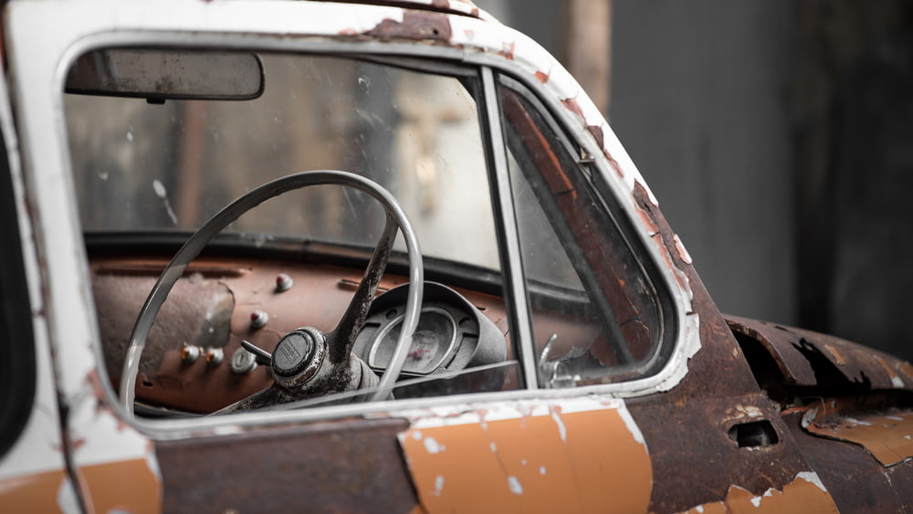 vintage brown and white car during daytime
