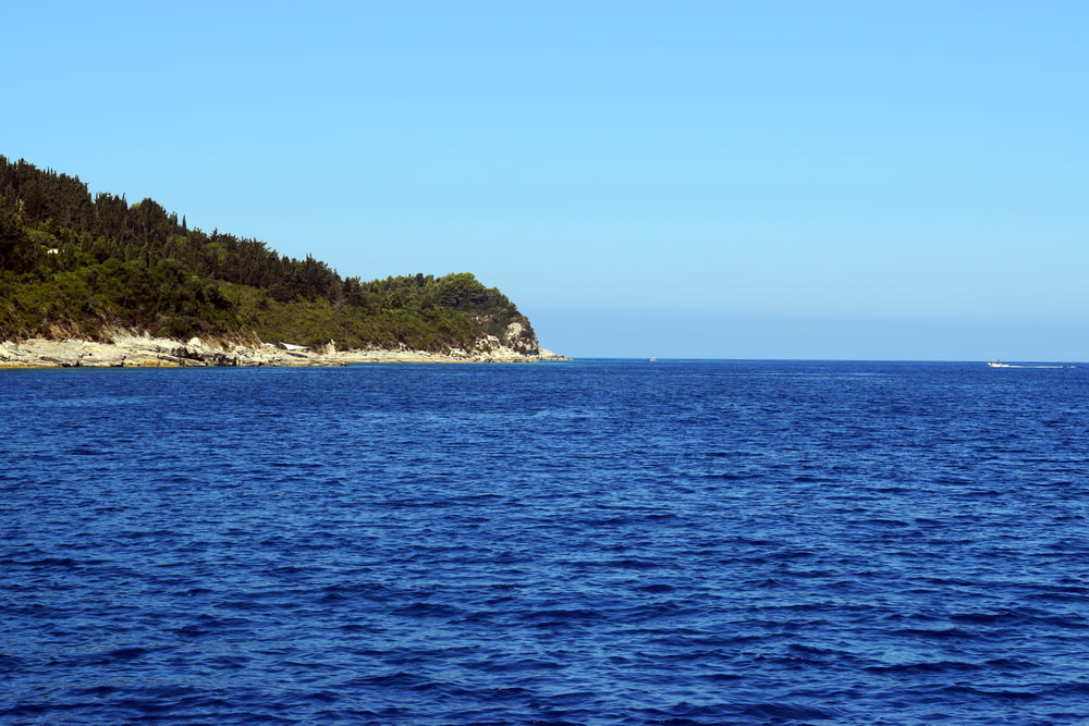 ocean and island during day