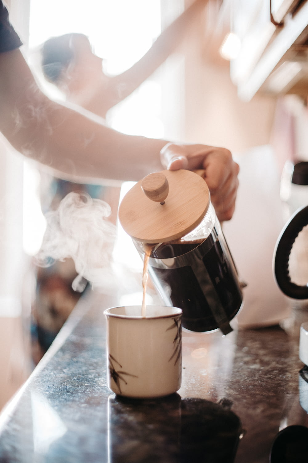 time-lapse photography of person pouring coffee on mug