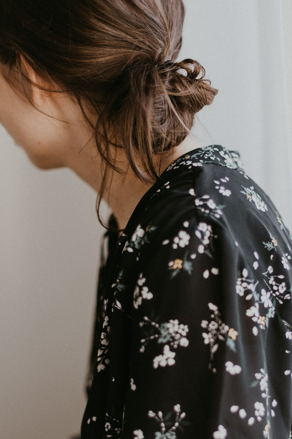 woman wearing black and white floral top