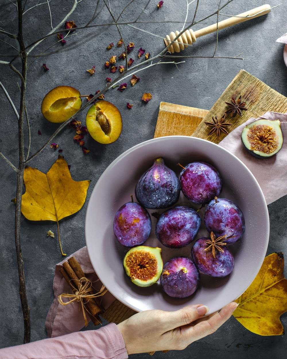 sliced purple fruits in bowl