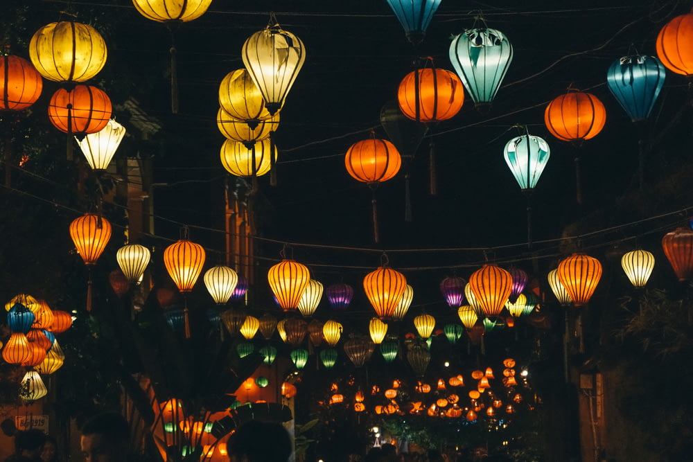 lighted Chinese lanterns hanged on rope