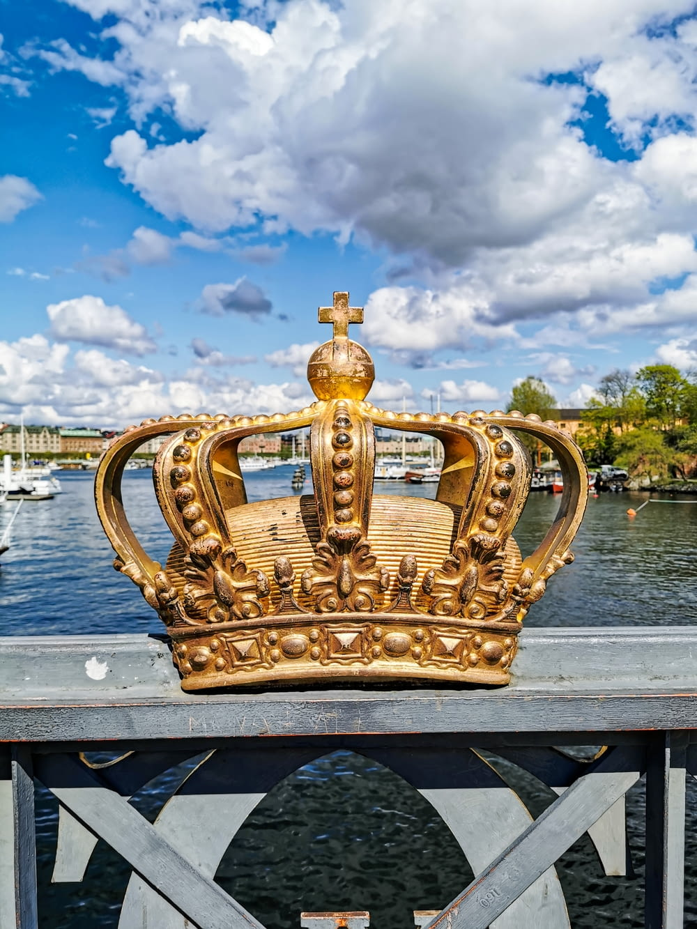 gold crown with a cumulus clouds in the background