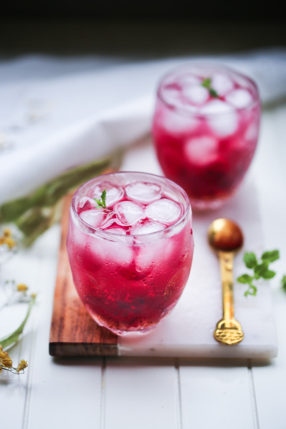 two glasses of red cocktail