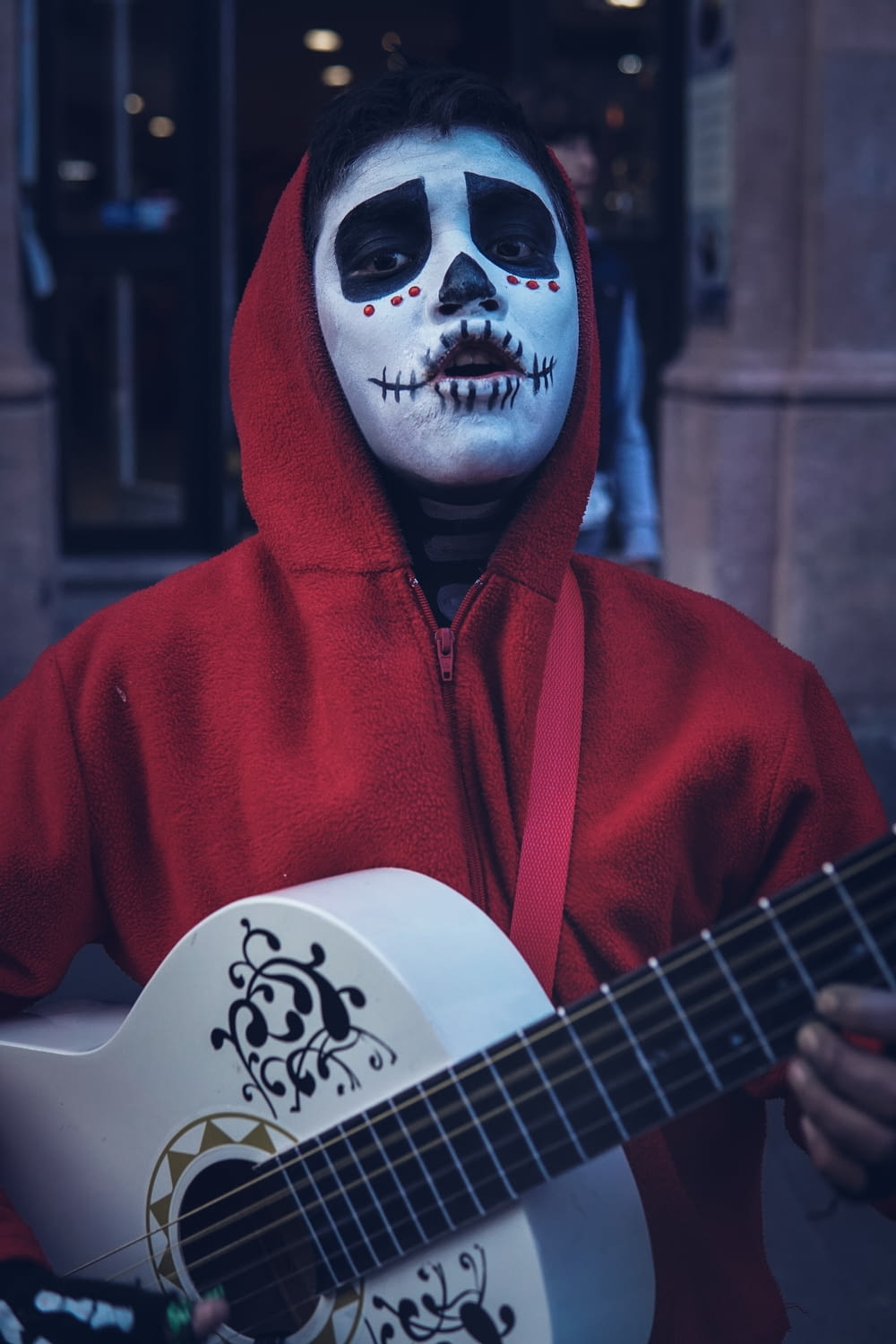 man wearing as Miguel of Coco