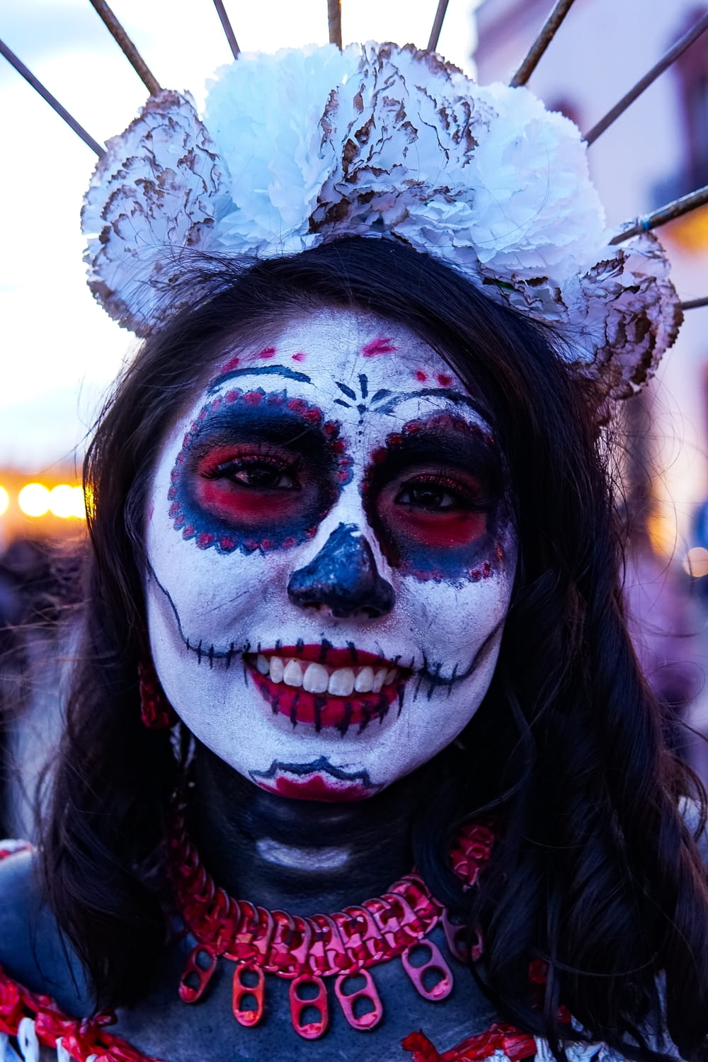 woman wearing calavera face paint
