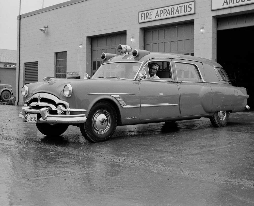 grayscale photography of man in vehicle