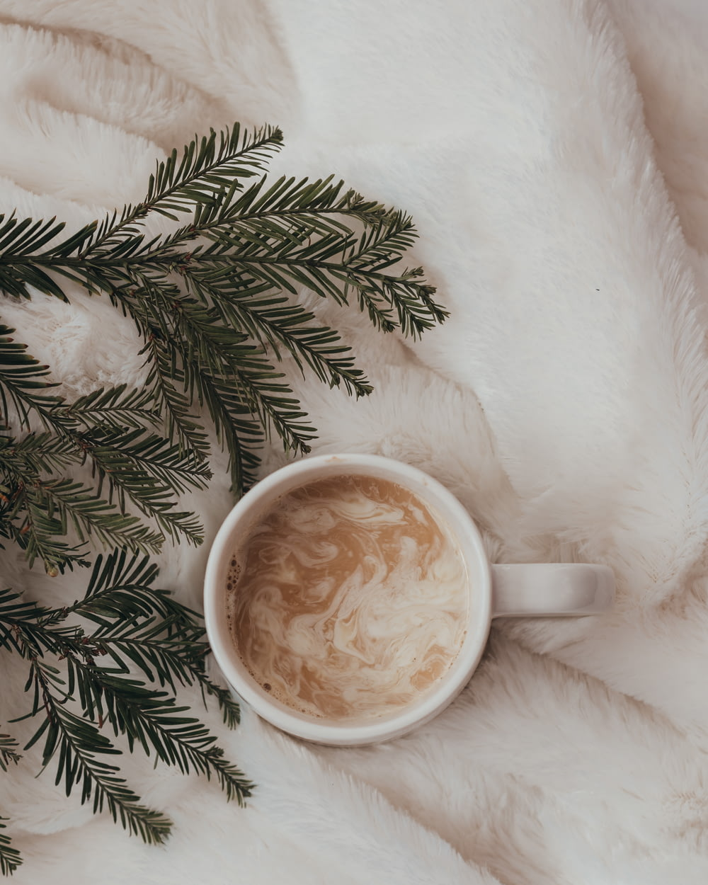 cup of coffee latte on fur textile
