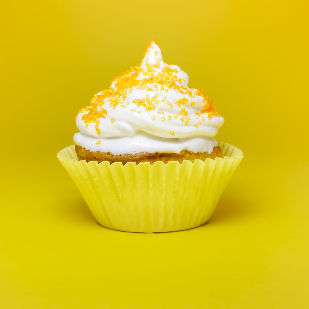 cupcake top with cream in yellow cupcake holder