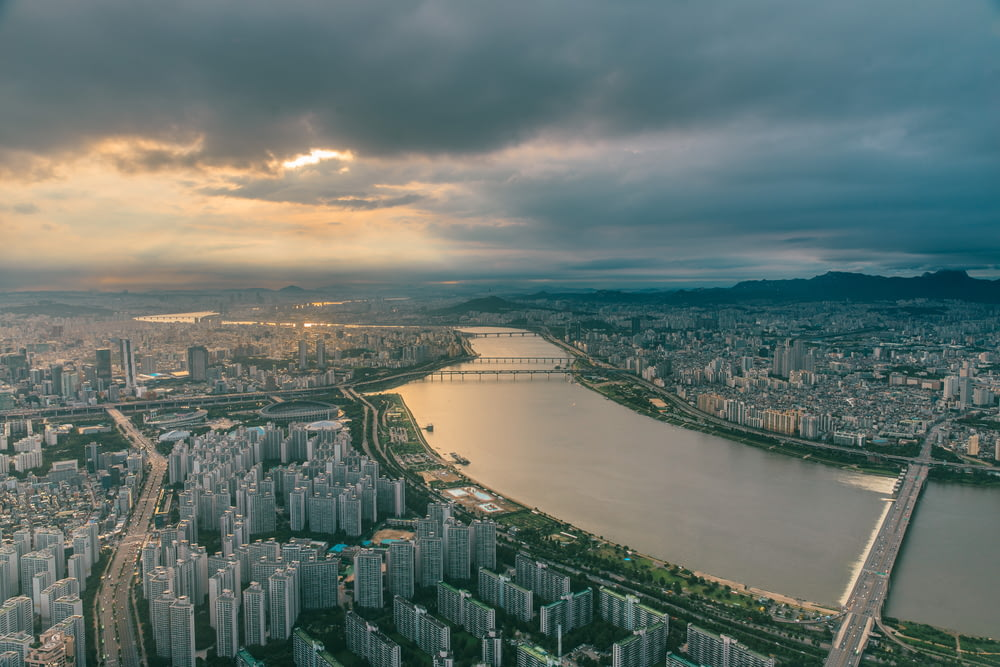aerial photography of city skyline under cloudy sky