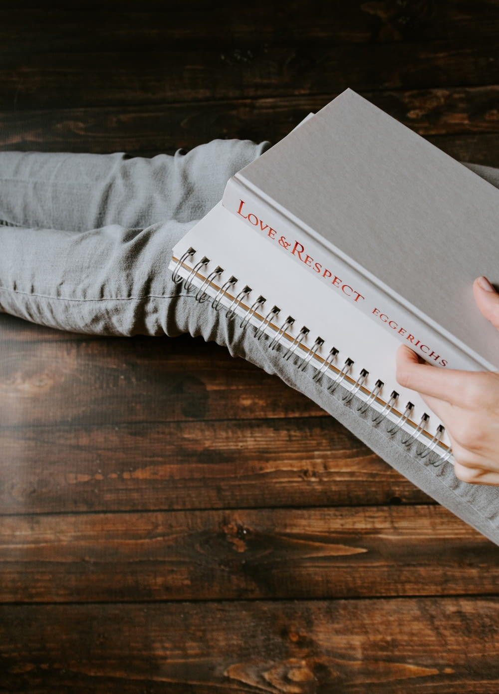 person holding white notebook