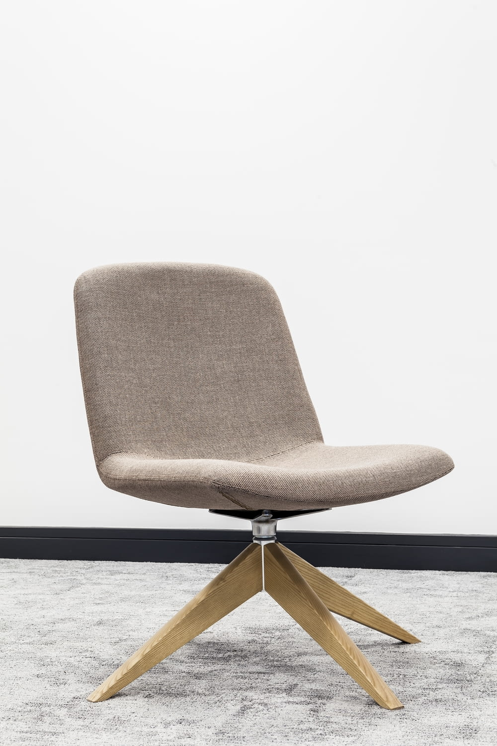 brown wooden framed gray padded chair