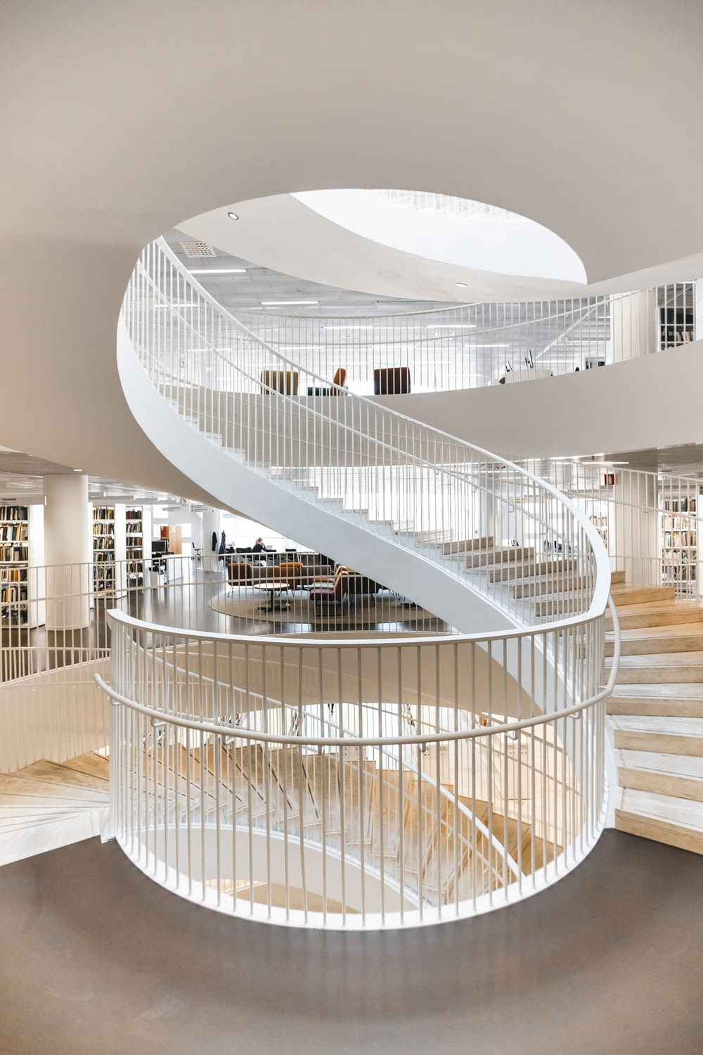 white spiral staircase with stainless steel railings