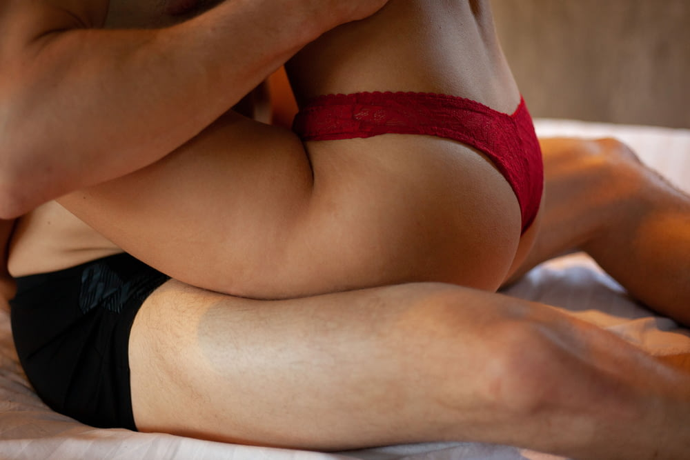 woman in red brassiere and black panty