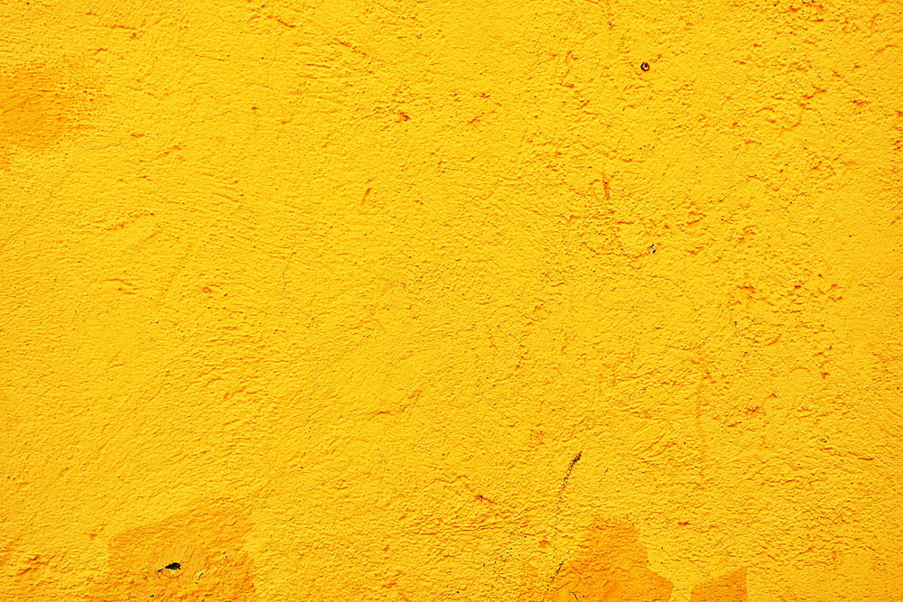 yellow concrete wall during daytime