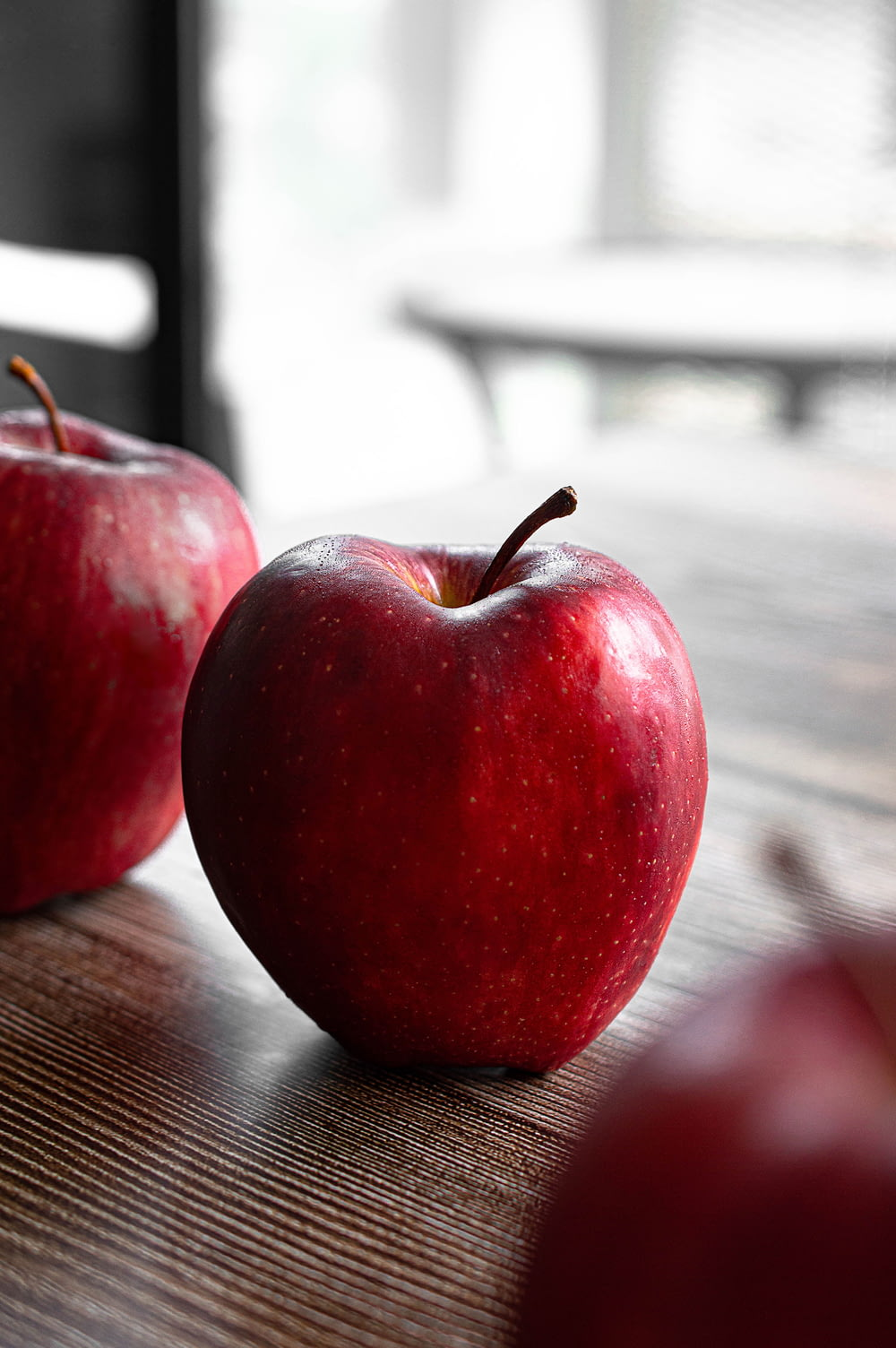 red apple on brown wooden table