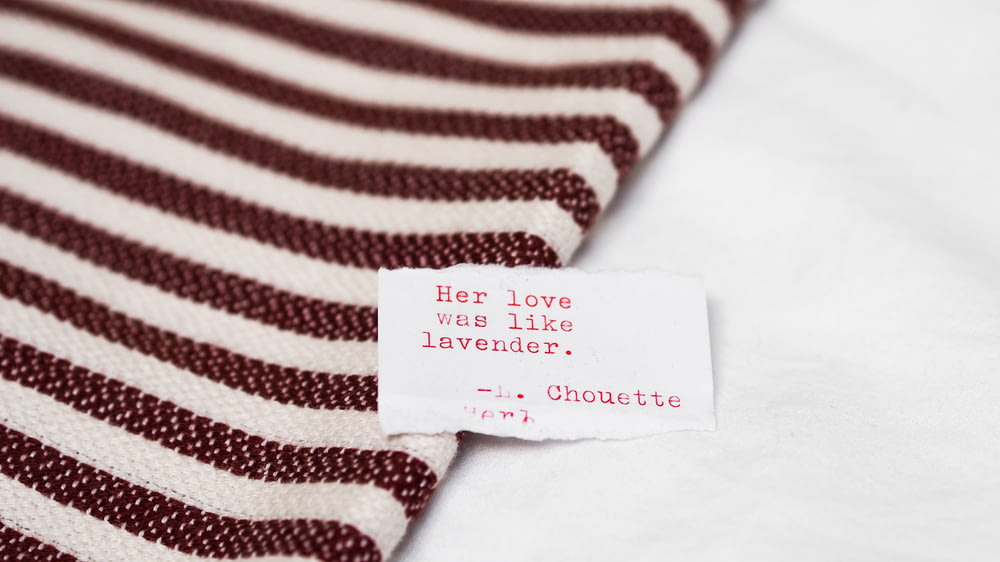white and red stripe textile