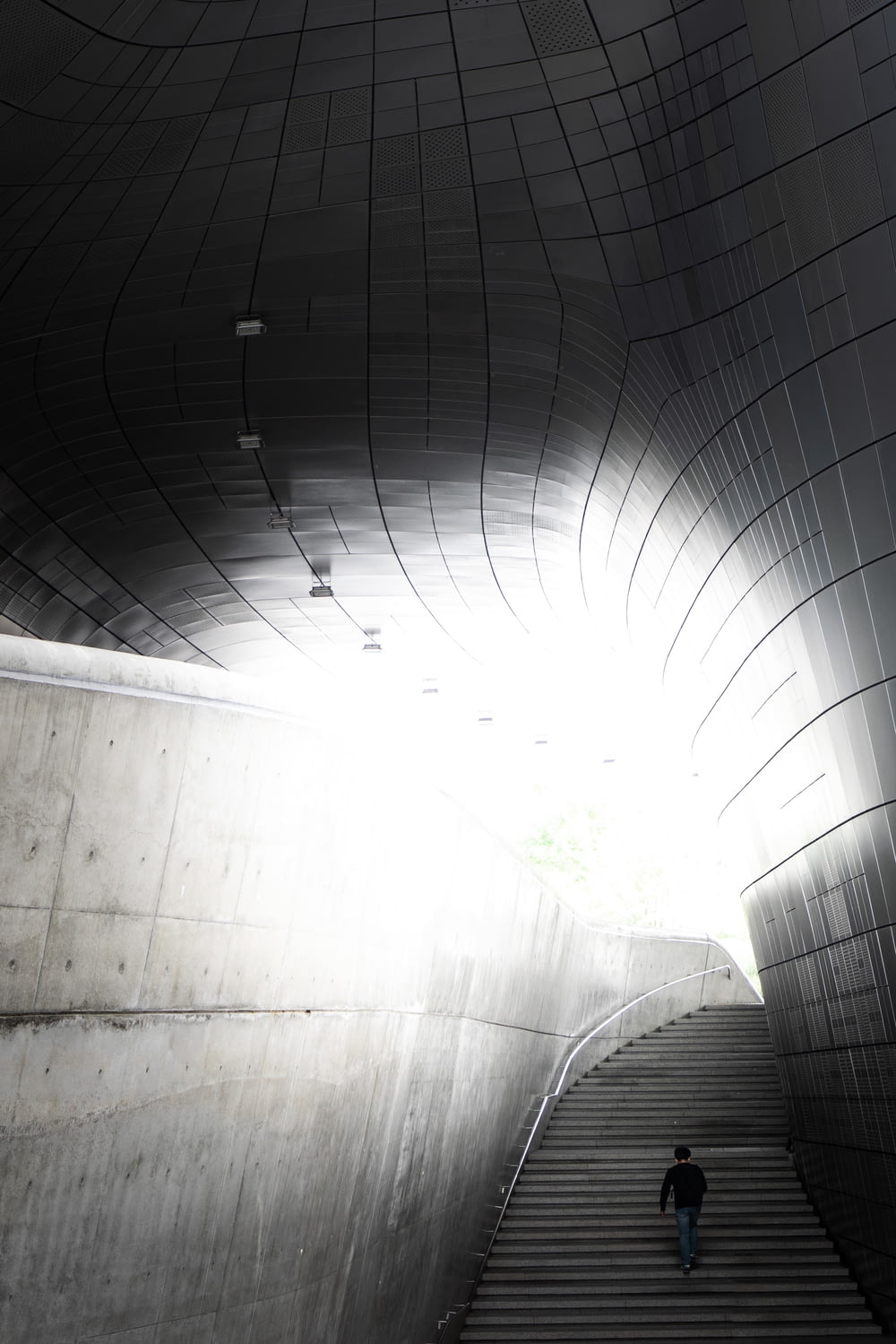 white concrete tunnel with green plants