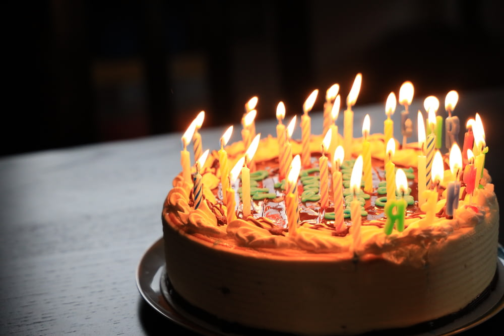 lighted candles on brown cake