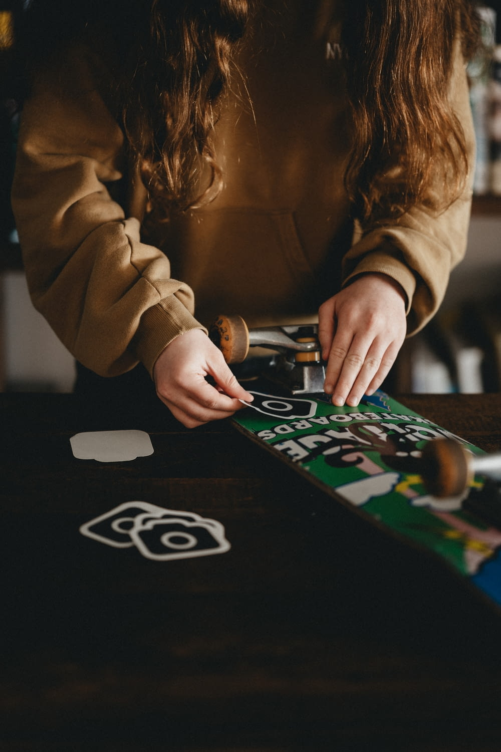 woman in brown long sleeve shirt playing game