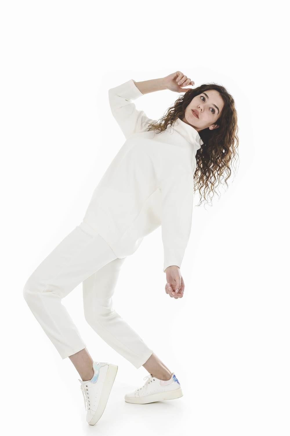 woman in white long sleeve shirt and white pants