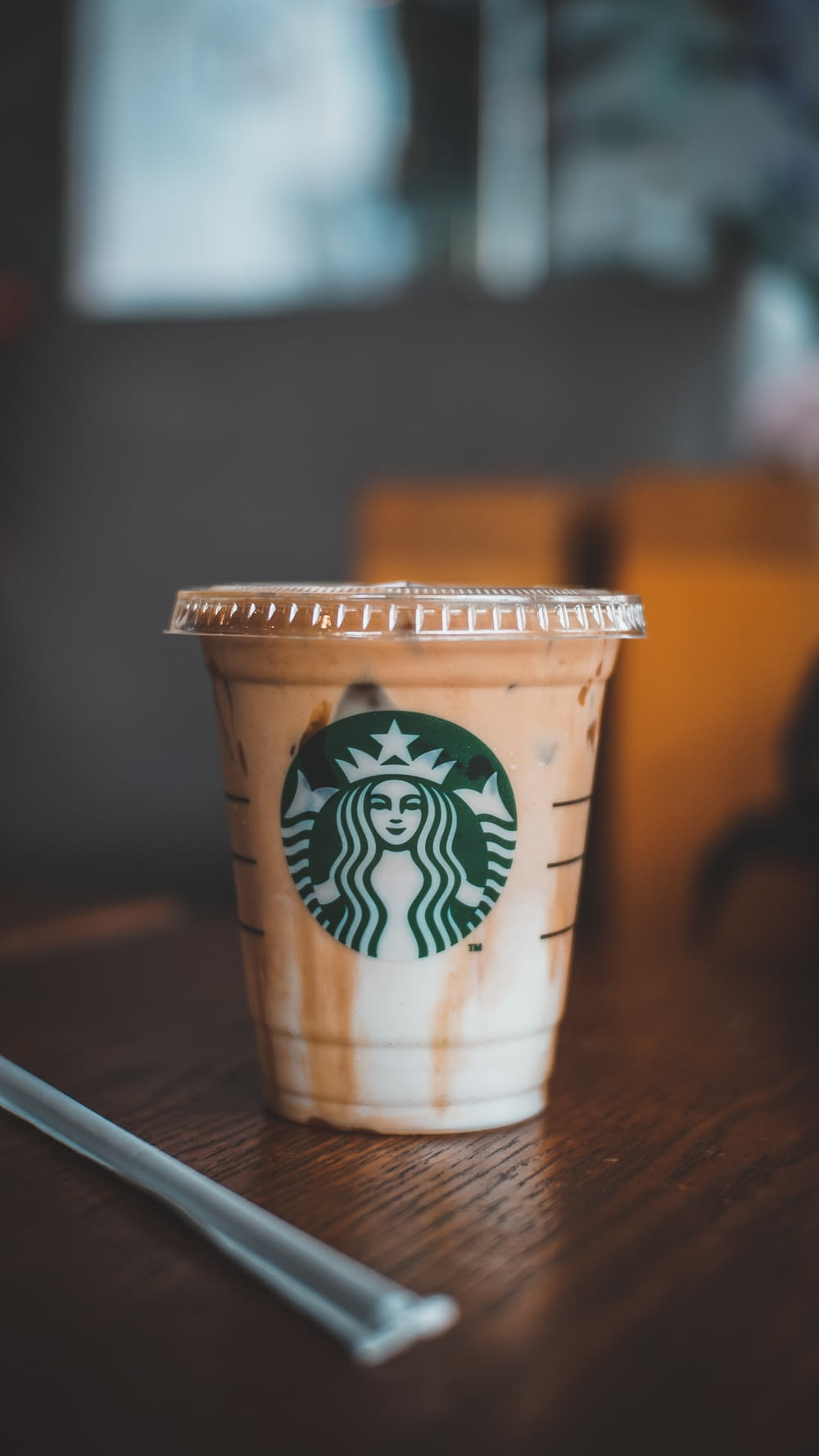 white and brown starbucks cup