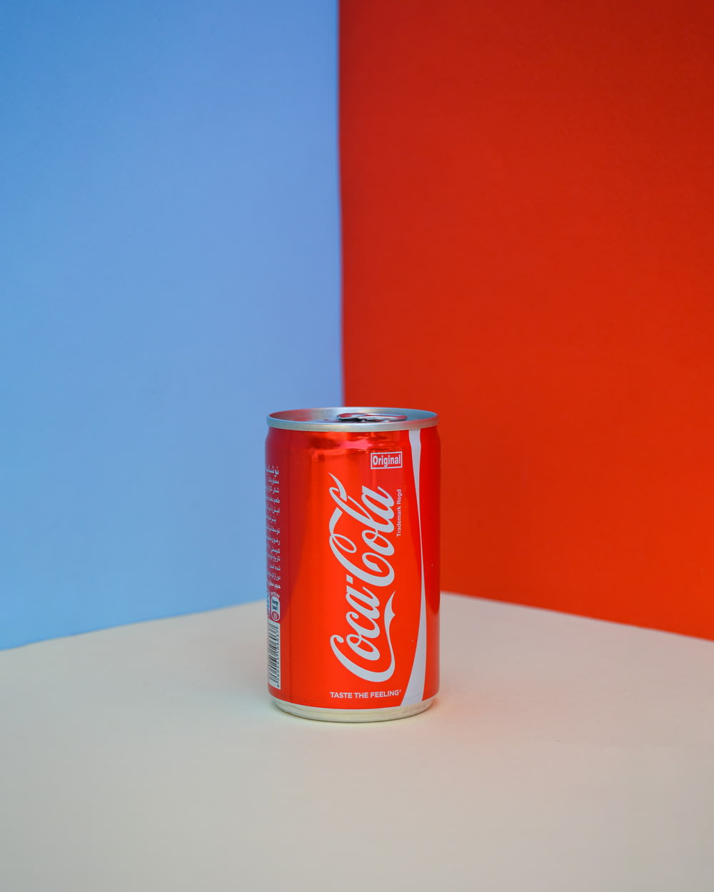 coca cola can on white table