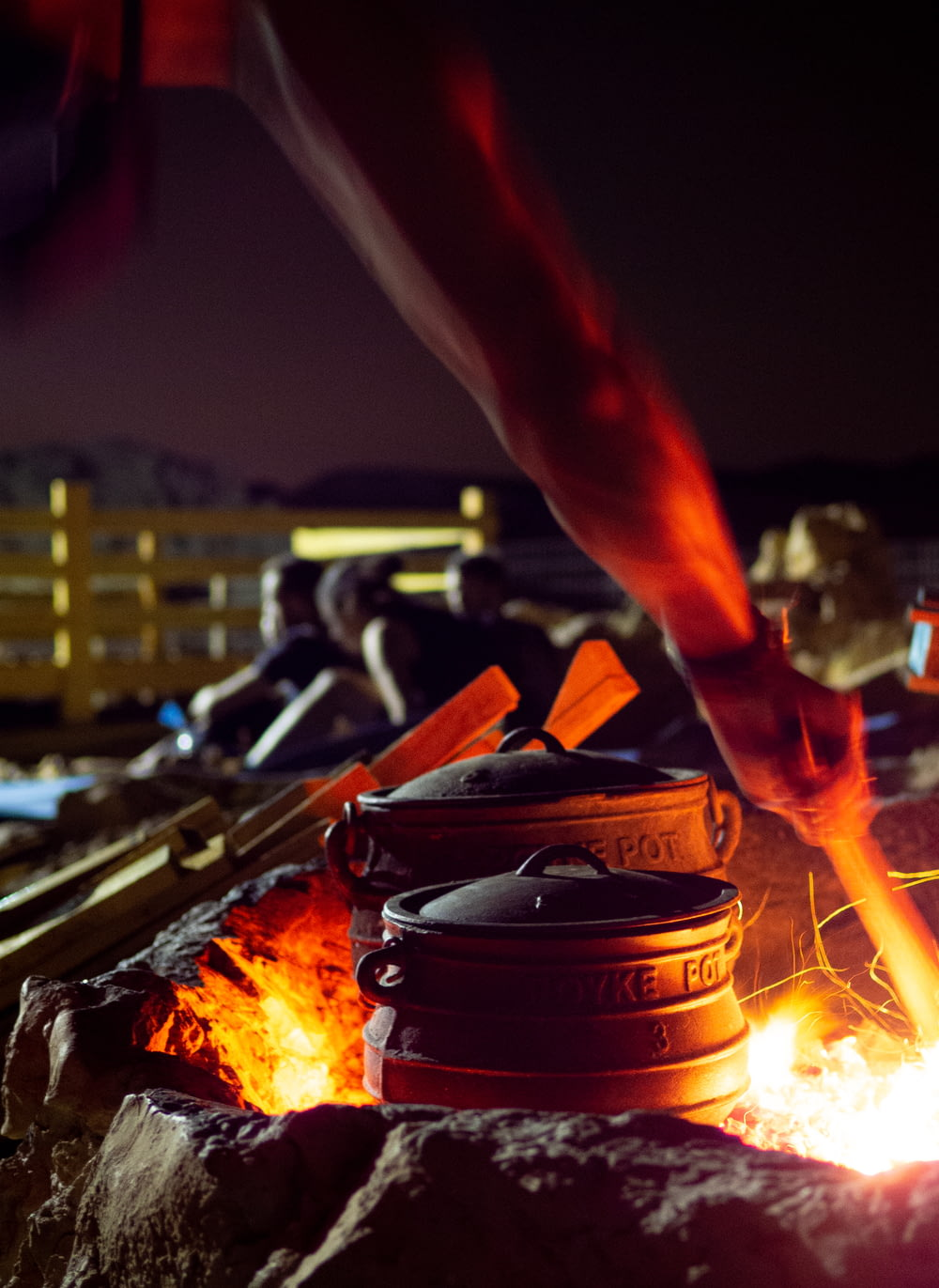 person holding black round container with fire during night time