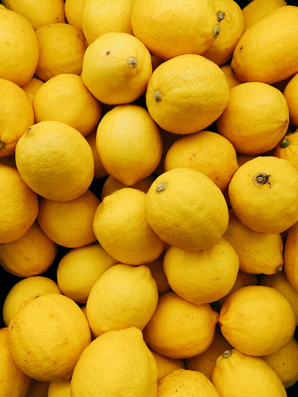 yellow citrus fruits on black surface