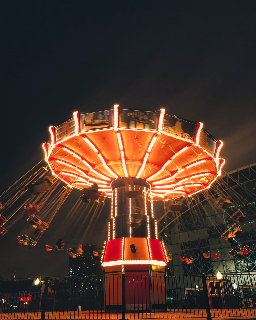 people walking on amusement park during night time