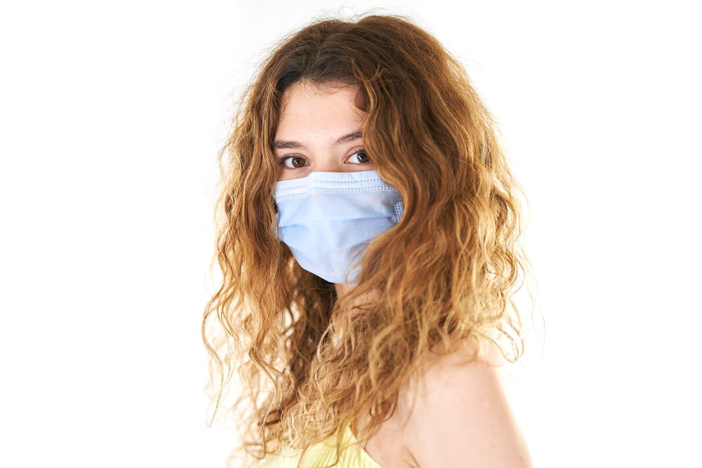 woman in white tank top with white face mask