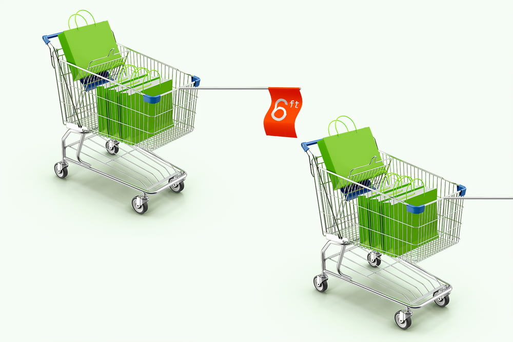 green shopping cart with red and green shopping bags
