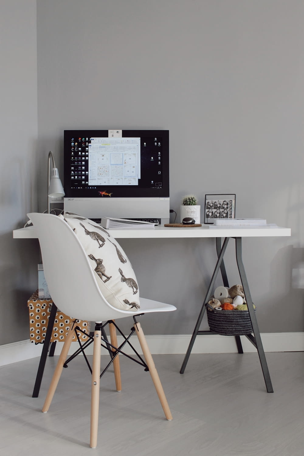 black flat screen computer monitor on white wooden table