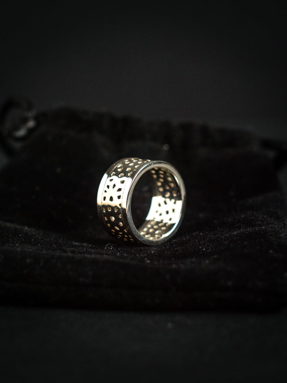 silver ring on black textile