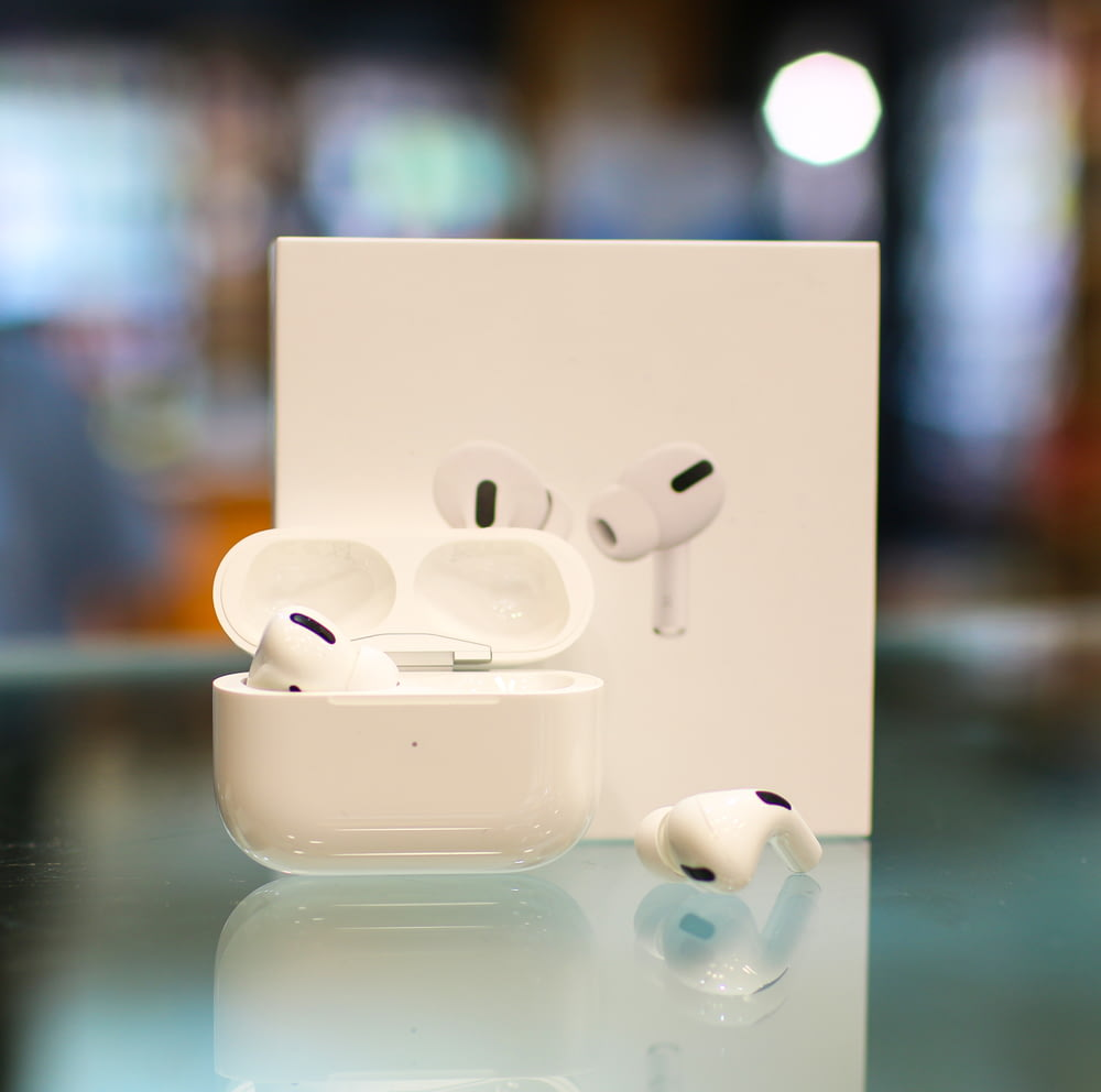 white apple earpods on white surface