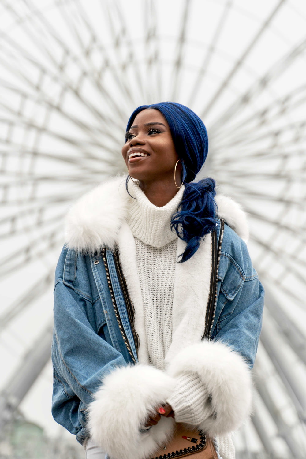woman in blue denim jacket and white scarf