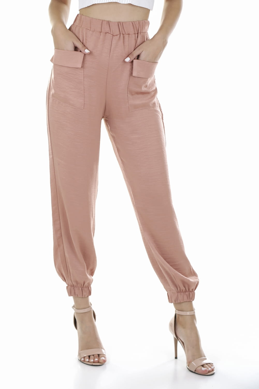 person in pink pants and white shoes