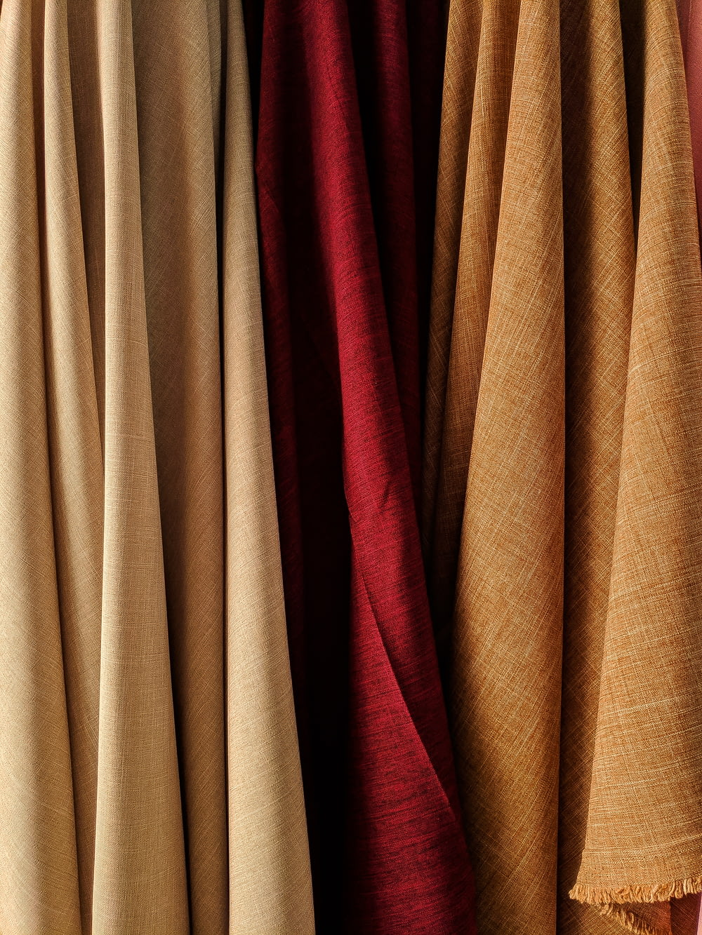 brown and red textile beside brown textile
