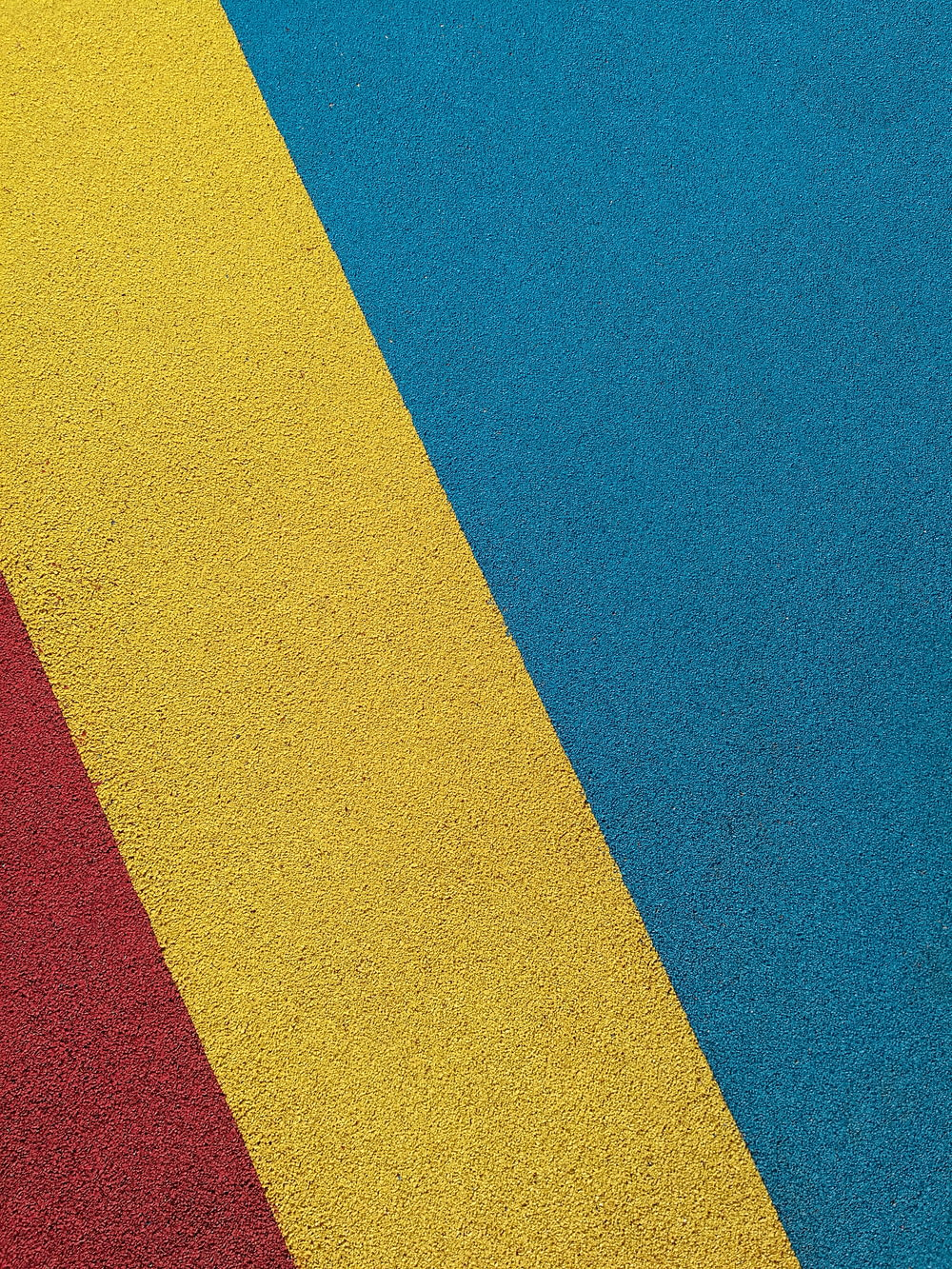 yellow red and blue striped textile