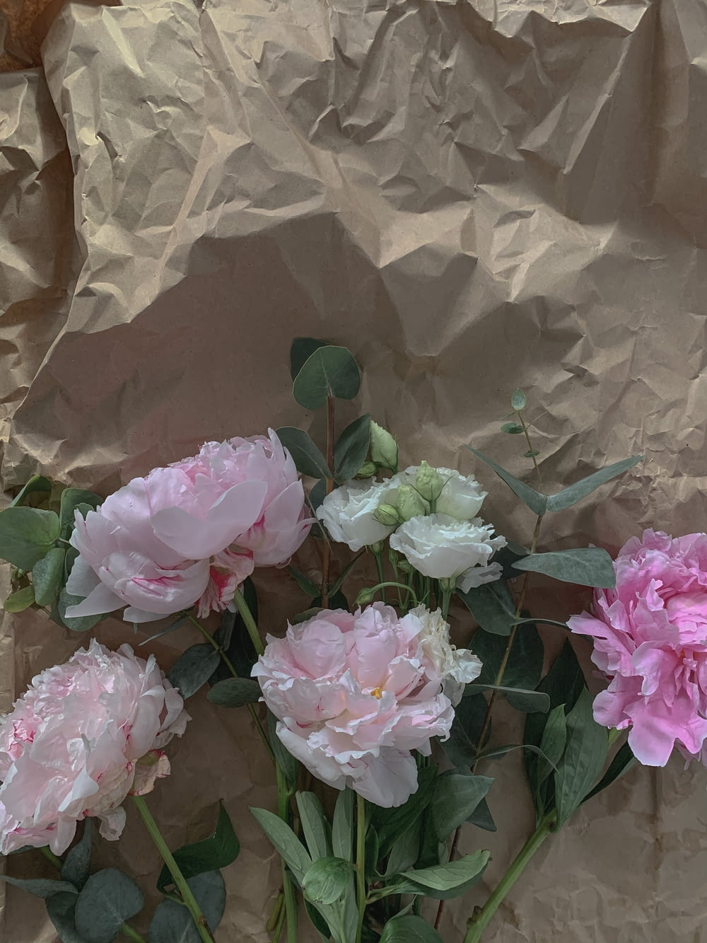 pink roses on brown plastic bag