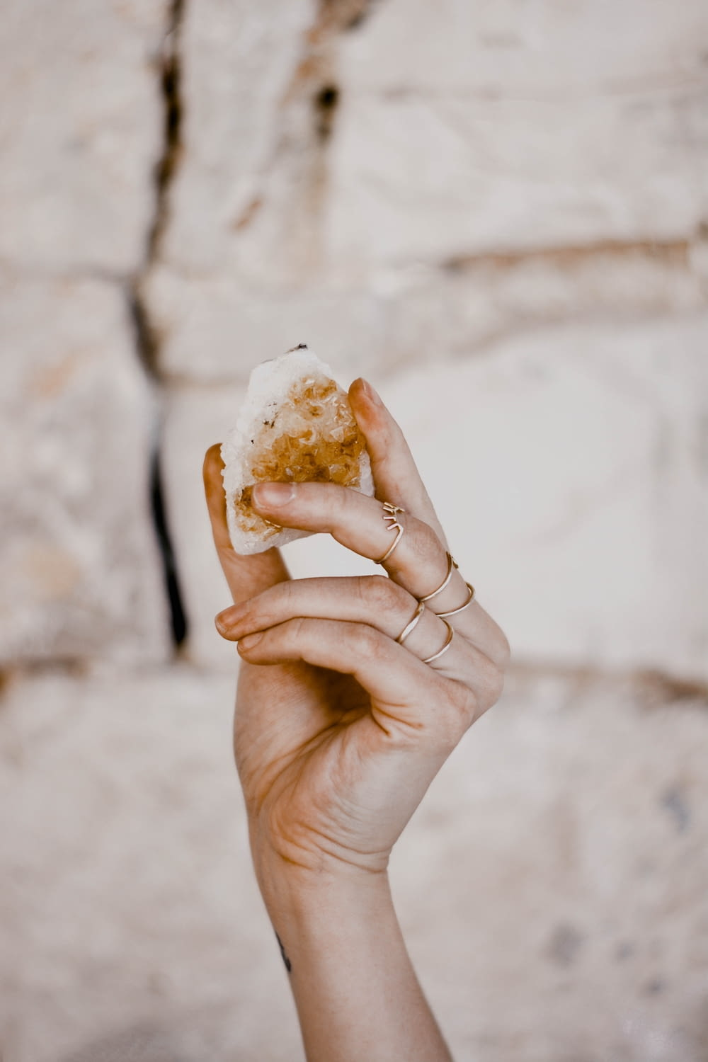 person holding bread with cheese