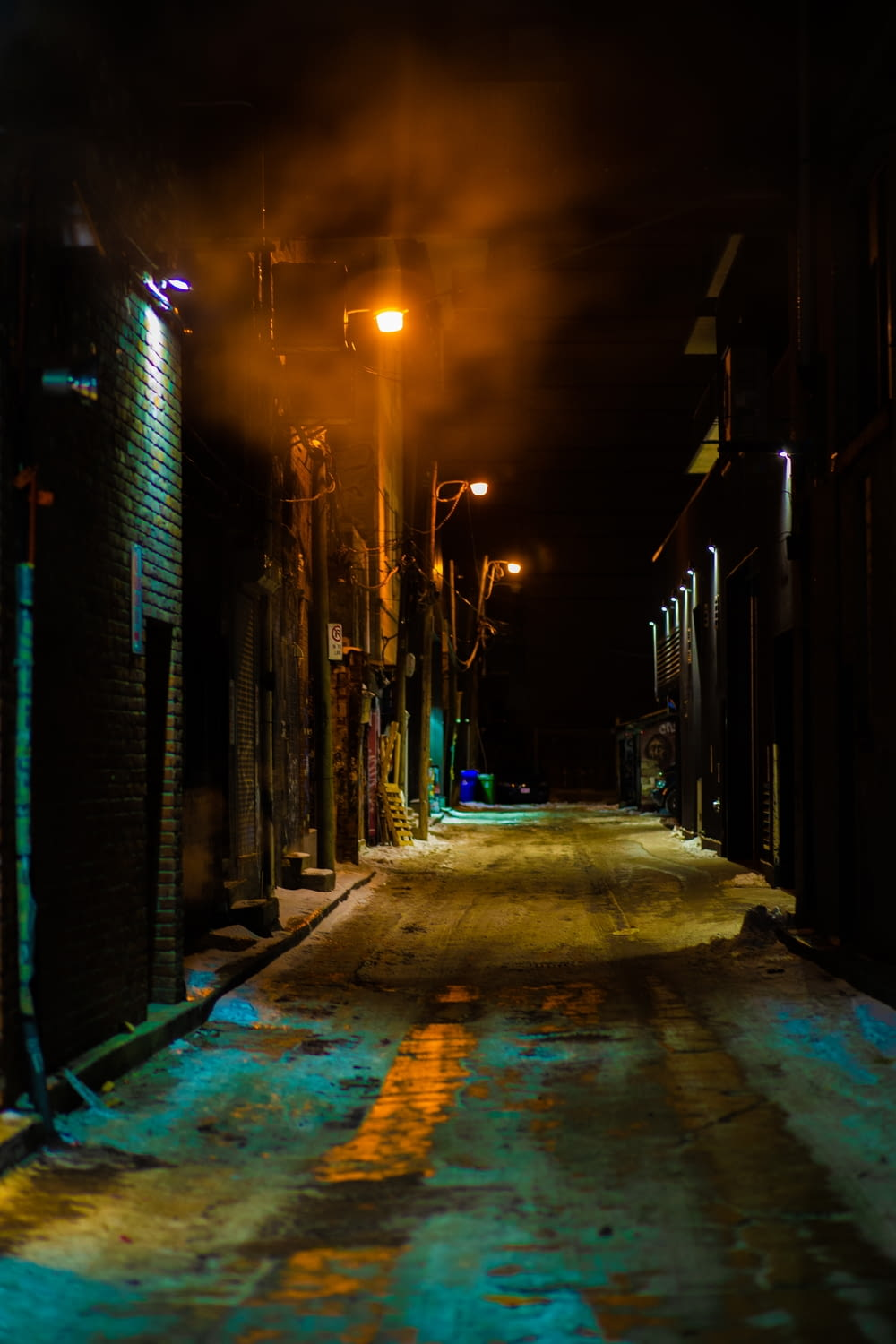 empty street between buildings during night time