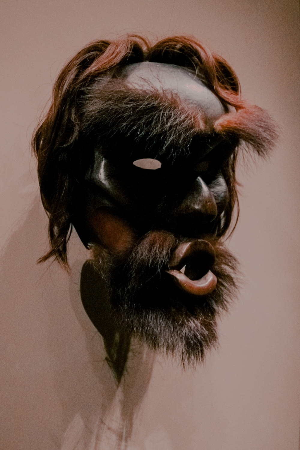 black and brown human face mask