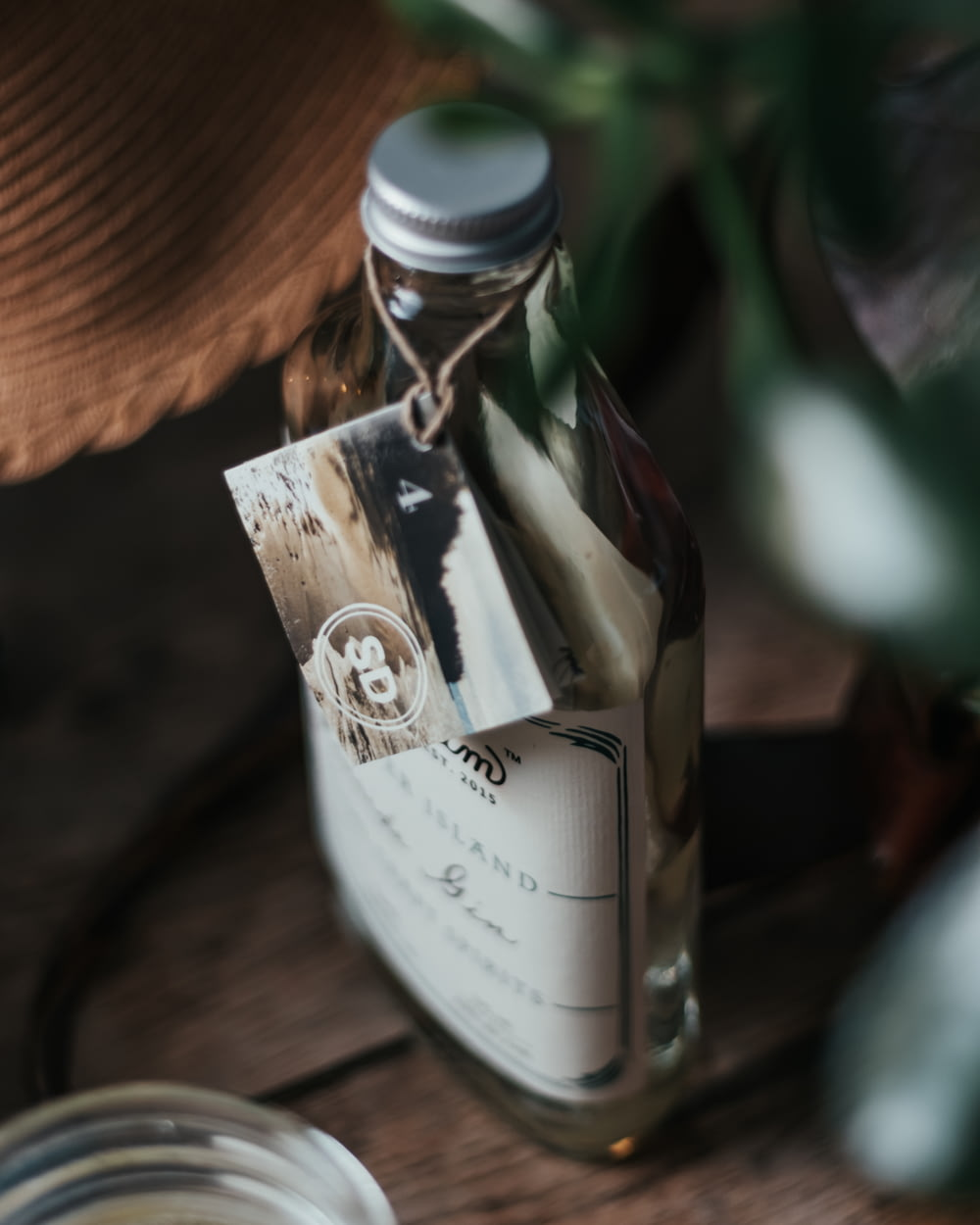 white labeled bottle on brown wooden table