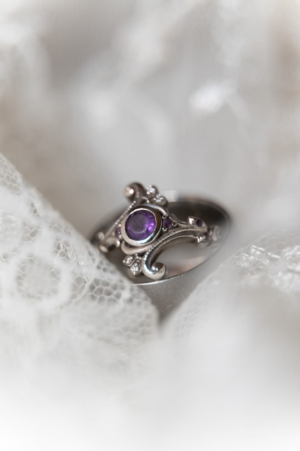 silver and purple gemstone ring