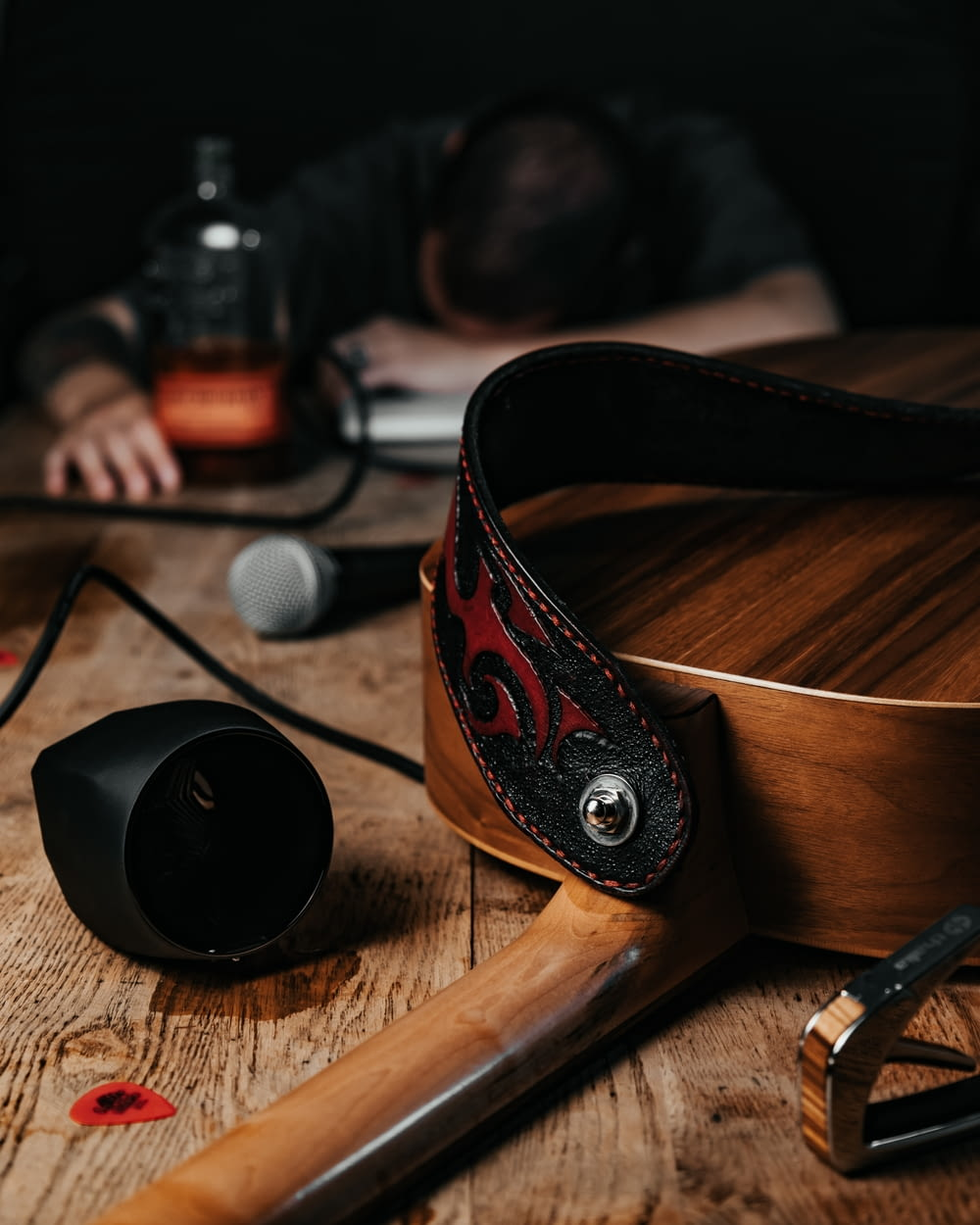 black and red headphones on brown wooden table