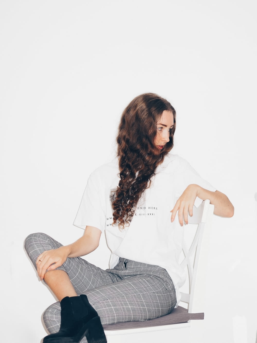 woman in white shirt sitting on white chair