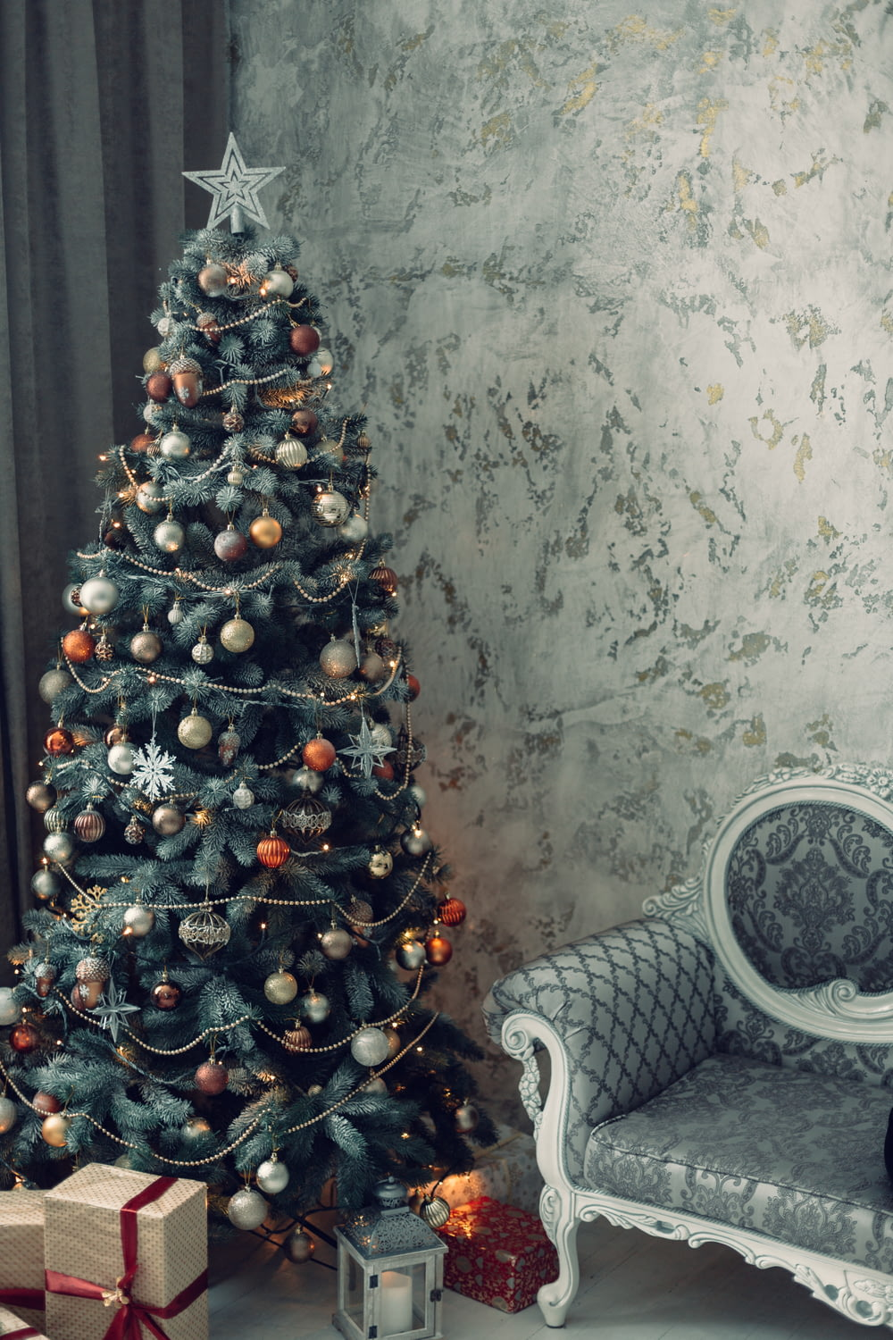 green christmas tree with red and white baubles